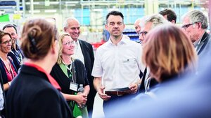 Production manager Christoph Homburger guides visitors through the factory halls